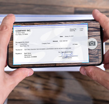 Person using smartphone to deposit a check