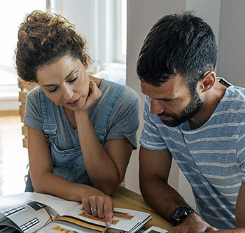 Couple looking at home improvement documents