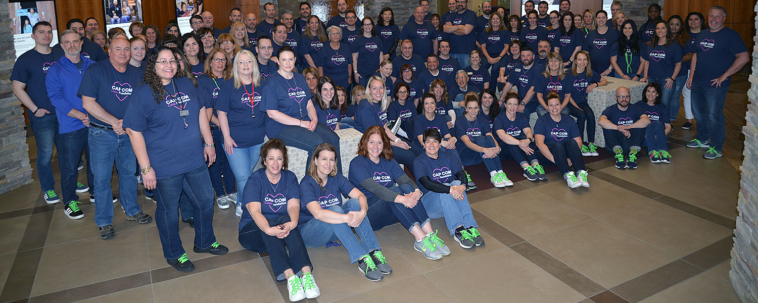 CAP COM volunteers grpup photo during Mental Health Awareness Month